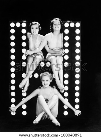 Three young women posing with the letter H - stock photo