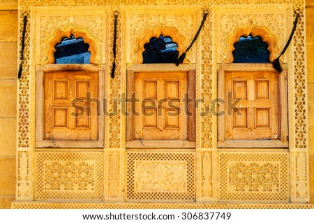 Threee traditional windows and pattern of Golden Fort of Jaisalmer, Rajasthan India with copy space - stock photo
