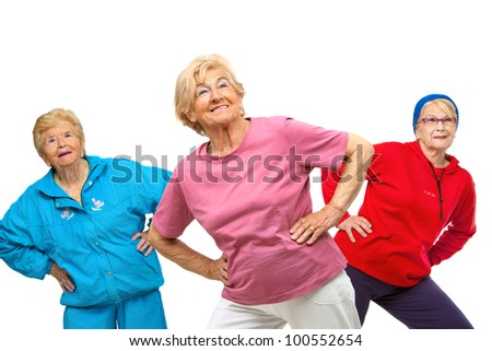 Threesome group of senior women doing stretching exercise.Isolated on white.