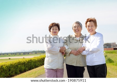 Threesome of an elderly woman a good relationship - stock photo