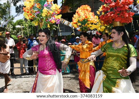 THRIPPUNITHURA, INDIA - SEPT 12: Ammankudam artists perform during the Onam festival procession. It is a temple dance prevalent in South India. September 12, 2015 in Thrippunithura, Kerala,India. - stock photo