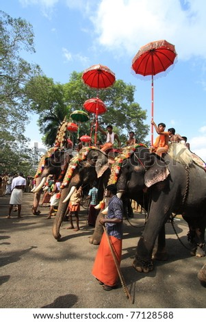 THRISSUR, INDIA - MAY 12 : Decorated elephants stand in line for procession at Elephant Festival on May 12, 201 in Thrissur, India. Thrissur Pooram is the most popular elephant festival in India.