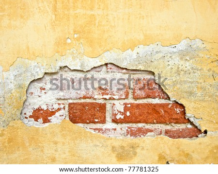 Through a hole in a wall it is visible bricks - stock photo