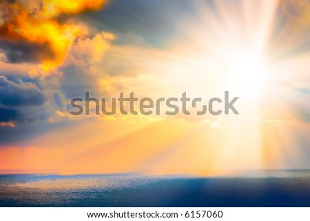 Through clouds on the sea light flows - stock photo