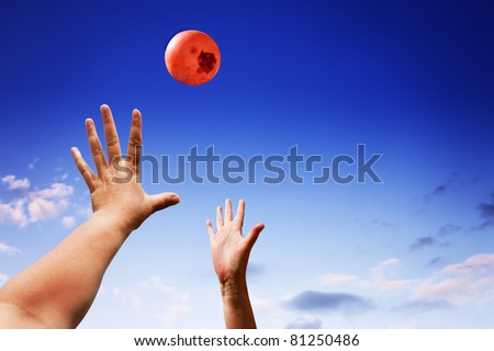 Throwing a ball in the air - stock photo