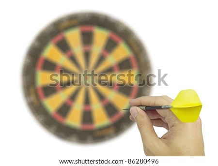 throwing a dart at a dartboard - stock photo