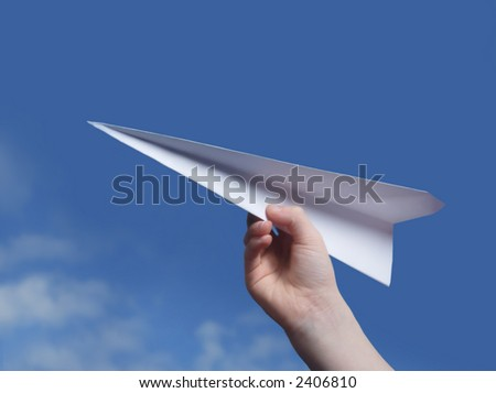 throwing a paper plane.. - stock photo