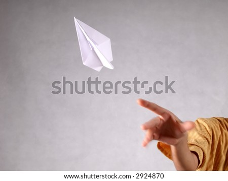 throwing a paper plane - origami - stock photo