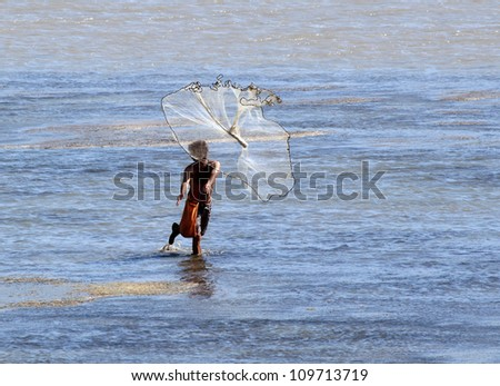 throwing fishing net - stock photo