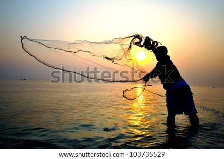throwing fishing net during sunrise, Thailand - stock photo