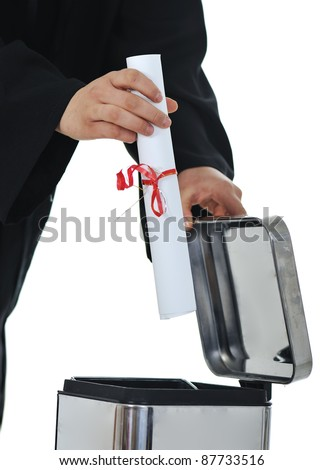 Throwing graduate diploma in trash, conceptual image - stock photo