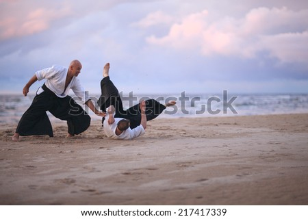 Throwing opponent to the ground, martial art technique - stock photo