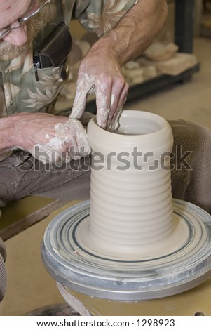 Throwing pottery 14 - stock photo