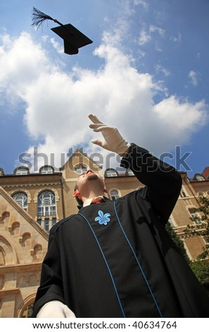 Throwing the mortar in happiness outdoor - stock photo