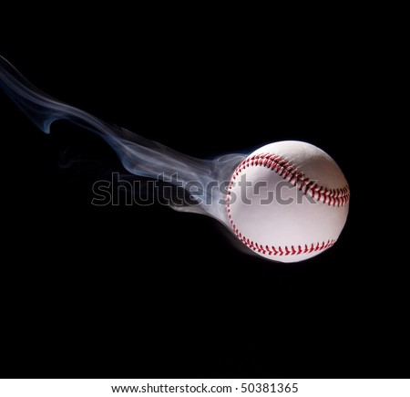 Thrown baseball with smoke against a black background - stock photo