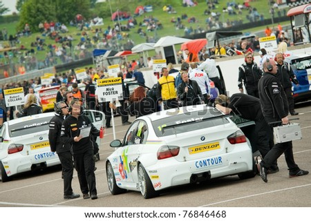 THRUXTON, UNITED KINGDOM - MAY 1: Hectic starting grid activity before a British Touring Car Championship race on May 1, 2011 in Thruxton, UK. - stock photo