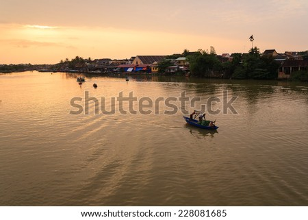 Thu Bon river in sunset, Hoi An Ancient Town, Quang Nam, Vietnam. Hoi An is recognized as a World Heritage Site by UNESCO. - stock photo