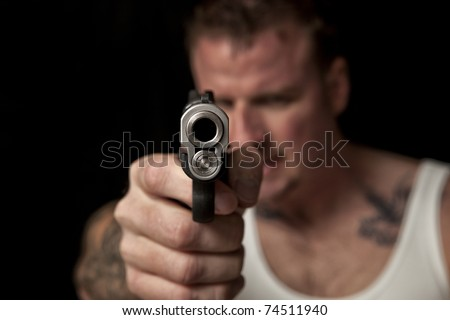 Thug Pointing a Gun - stock photo