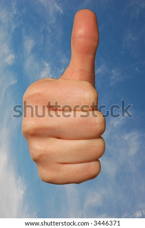 Thumb Up against blue sky - stock photo