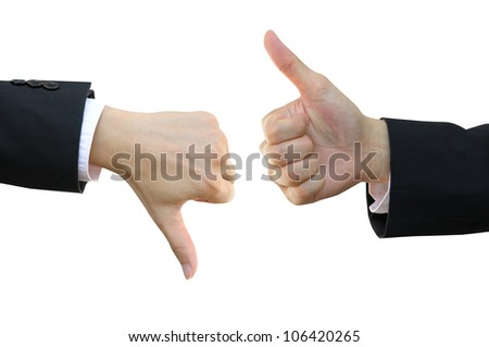 Thumb up and thumb down business man hand signs - stock photo