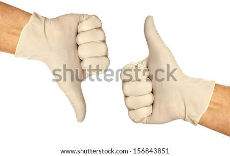 Thumb up and thumb down sign with a latex glove isolated on white background  - stock photo