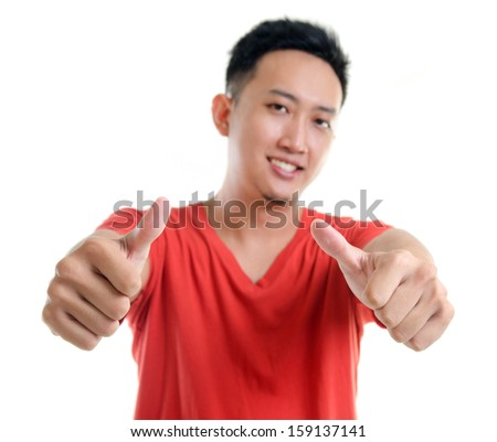 Thumb up cool young Southeast Asian man isolated over white background - stock photo