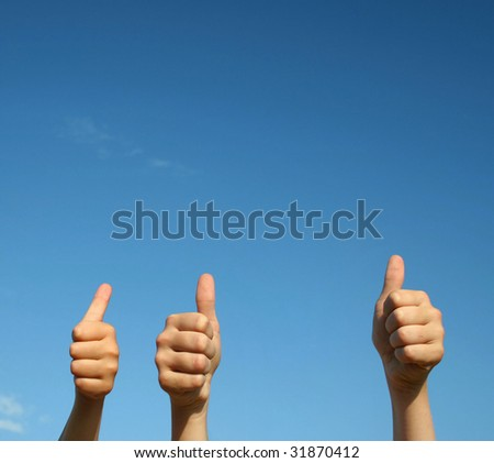 Thumb up gesture close-up - stock photo
