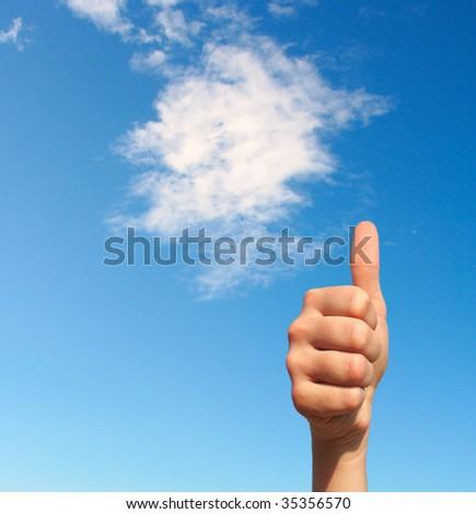 Thumb up gesture close-up - stock photo
