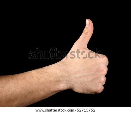Thumb up hand isolated on black background - stock photo