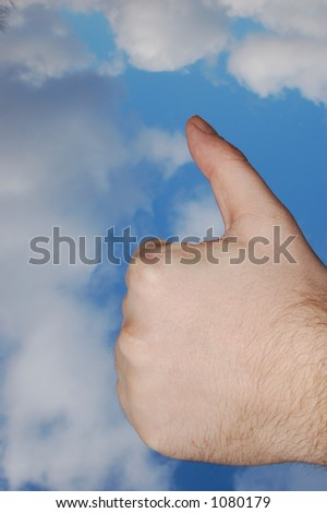 Thumb up on sky background #1 - stock photo