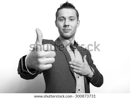 Thumb up.Person demonstrating  emotion of trust - stock photo