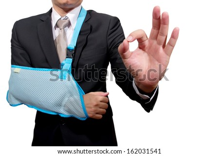 thumb up young businessman with broken hand wearing an arm brace, series - stock photo