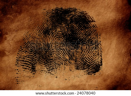 Thumbprint on old textured paper - stock photo