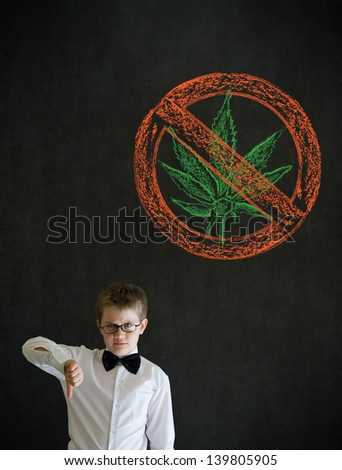 Thumbs down boy dressed up as business man with no weed marijuana on blackboard background - stock photo