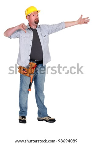 Thumbs down from a builder in empty copyspace - stock photo