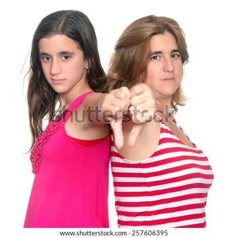 Thumbs down - Teenage girl and her mother doing the thumbs down hand gesture isolated on white - stock photo
