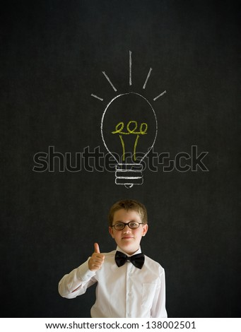 Thumbs up boy dressed up as business man with bright idea chalk background lightbulb on blackboard background - stock photo