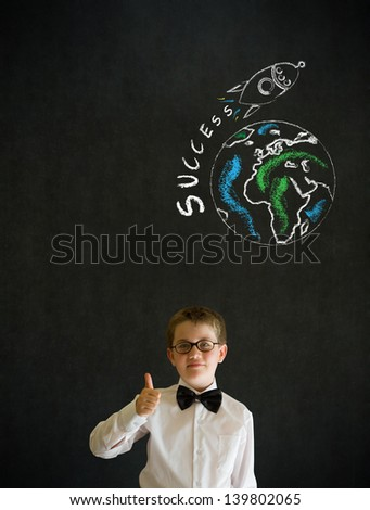 Thumbs up boy dressed up as business man with chalk globe and jet world travel on blackboard background - stock photo