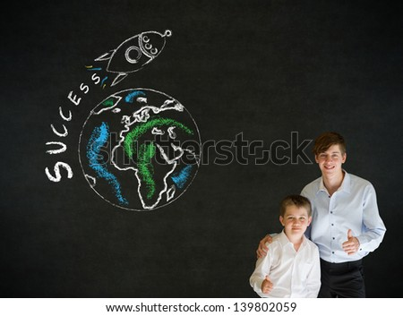 Thumbs up boy dressed up as business man with teacher man and chalk globe and jet world travel on blackboard background - stock photo