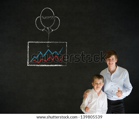 Thumbs up boy dressed up as business man with teacher man and chalk success graph and balloon on blackboard background - stock photo