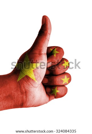Thumbs up digitally compositing on with China flag - stock photo