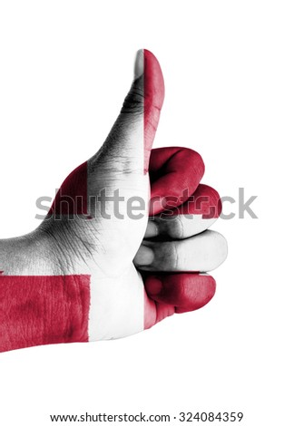 Thumbs up digitally compositing on with Denmark flag - stock photo