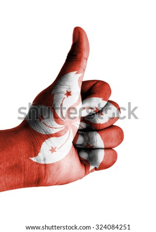Thumbs up digitally compositing on with Hong Kong flag - stock photo