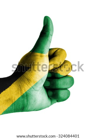 Thumbs up digitally compositing on with Jamaica flag - stock photo