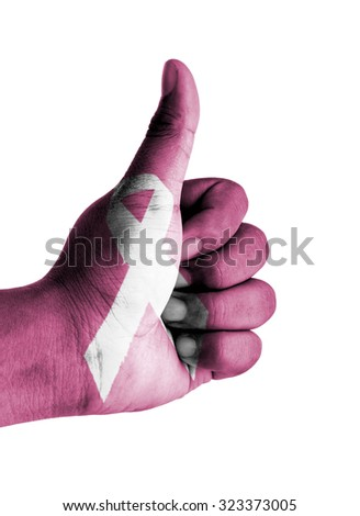 Thumbs up digitally compositing with breast cancer awareness ribbon on white background - stock photo