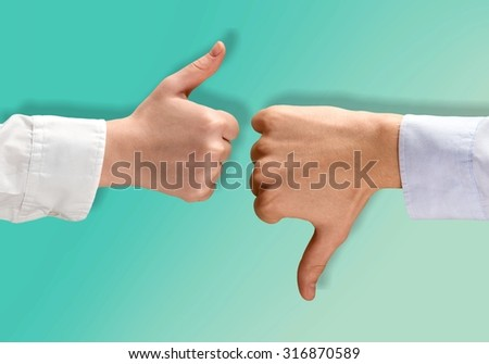Thumbs Up-Down. - stock photo