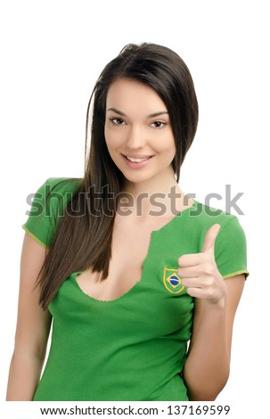 Thumbs up for Brazil. Attractive girl with Brazilian flag on her green t-shirt. Isolated on white. - stock photo