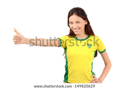 Thumbs up for Brazil. Attractive girl with Brazilian flag on her yellow  t-shirt. Isolated on white. - stock photo