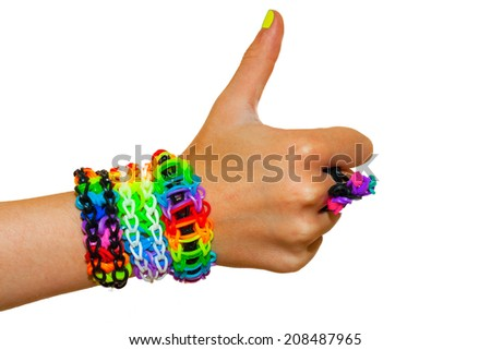 thumbs up for colorful rainbow loom rubber bands bracelet - stock photo
