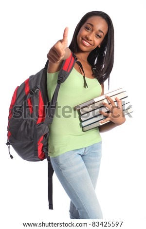 Thumbs up for successful education from pretty young African American teenager student girl with big beautiful smile wearing red backpack and holding school books. - stock photo